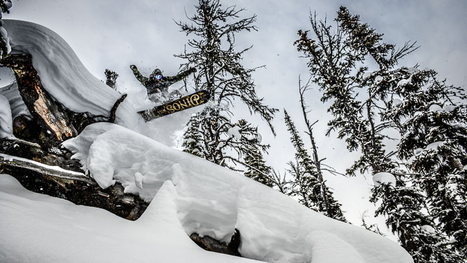 Snowboard Photography: Jeff Keenan airs into a Kicking Horse Mountain Resort pillow line.