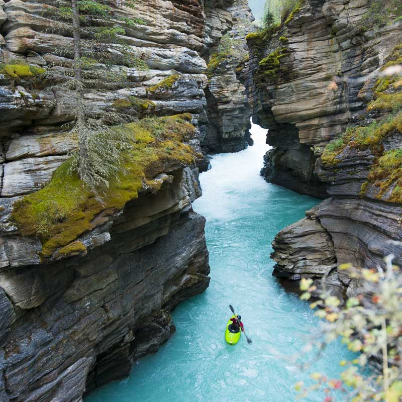 Paddling beneath Athabasca Falls in Jasper National Park