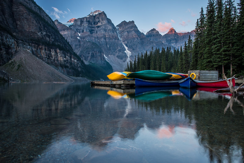 The canoe docks during a Moraine Lake sunrise
