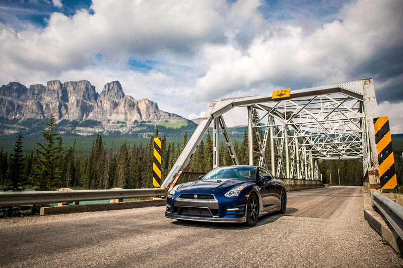 The Motor Trends Magazine Nissan GTR Black Edition parked at Castle Mountain in Banff National Park.