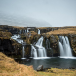 Intertwined waterfalls carve through the Icelandic Landscape