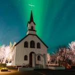 Northern Lights dance above an Icelandic Church