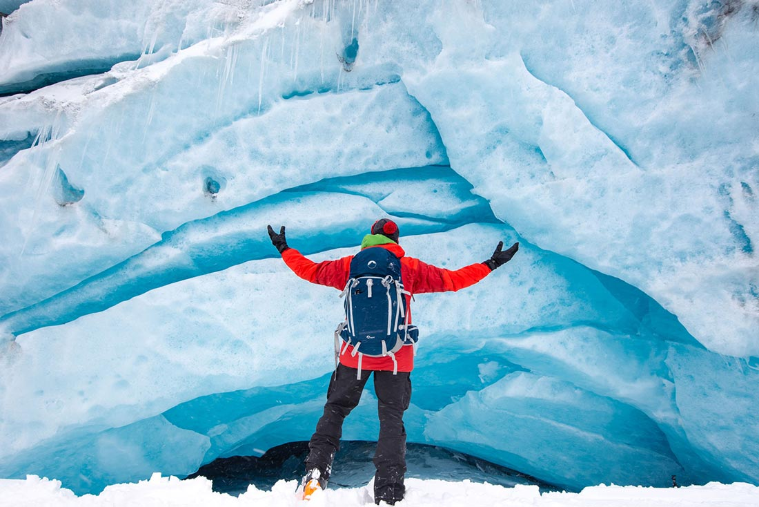 Standing in front of the Athabasca Glacier icecave with my lowepro rover backpack.