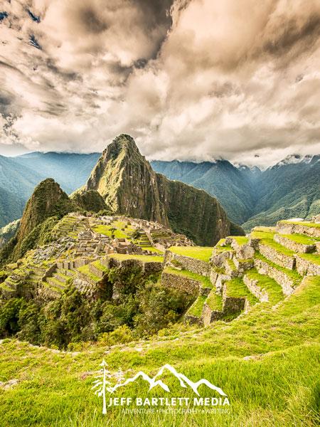 A portrait oriented image of Machu Picchu mountain, taken by adventure photographer Jeff Bartlett