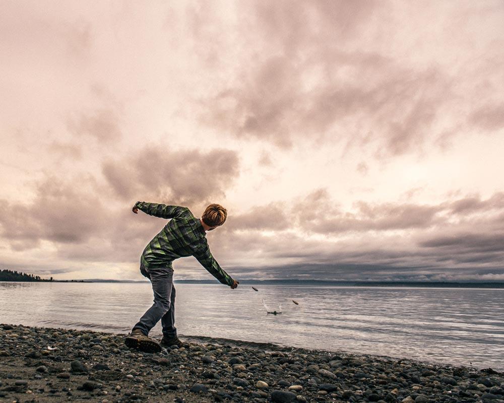 Meet Hello America, busy skipping rocks at the Eddie Bauer Live Your Adventure summit in Seattle, Washington