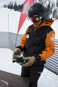 a ski patroller demonstrates how to work an avalanche transciever
