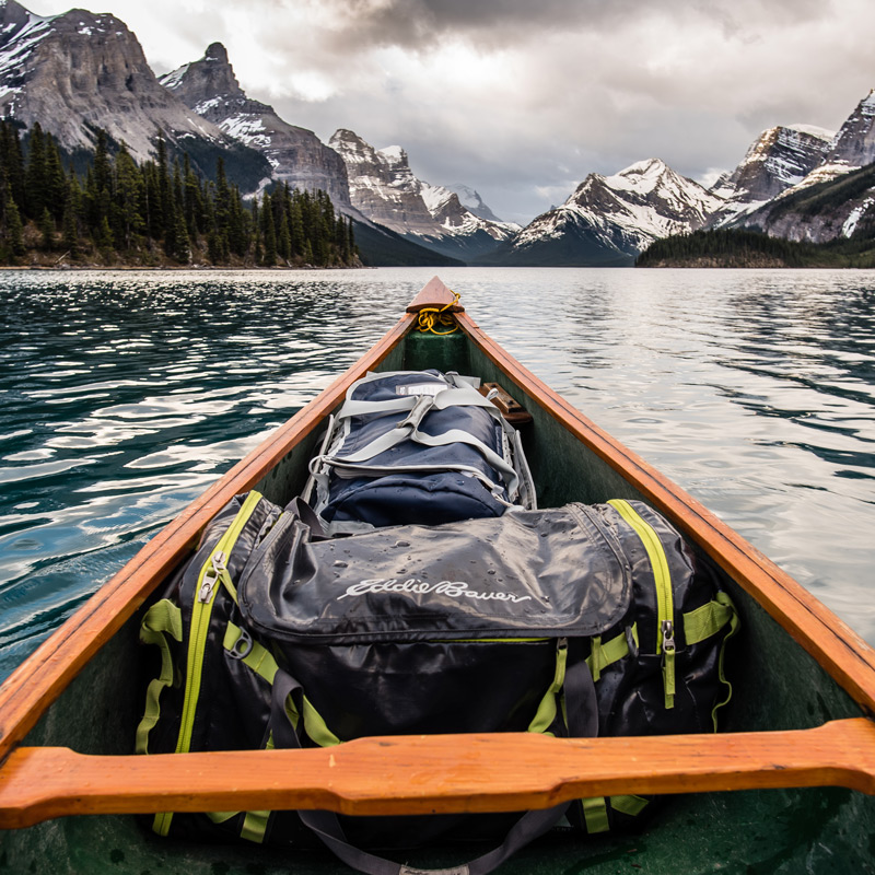 Canoe trips in jasper, like this adventure on maligne lake, is the ideal start to summer