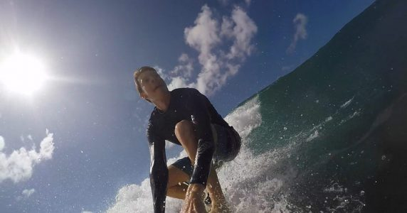 Leave a trace founder takes a moment away from the office to surf