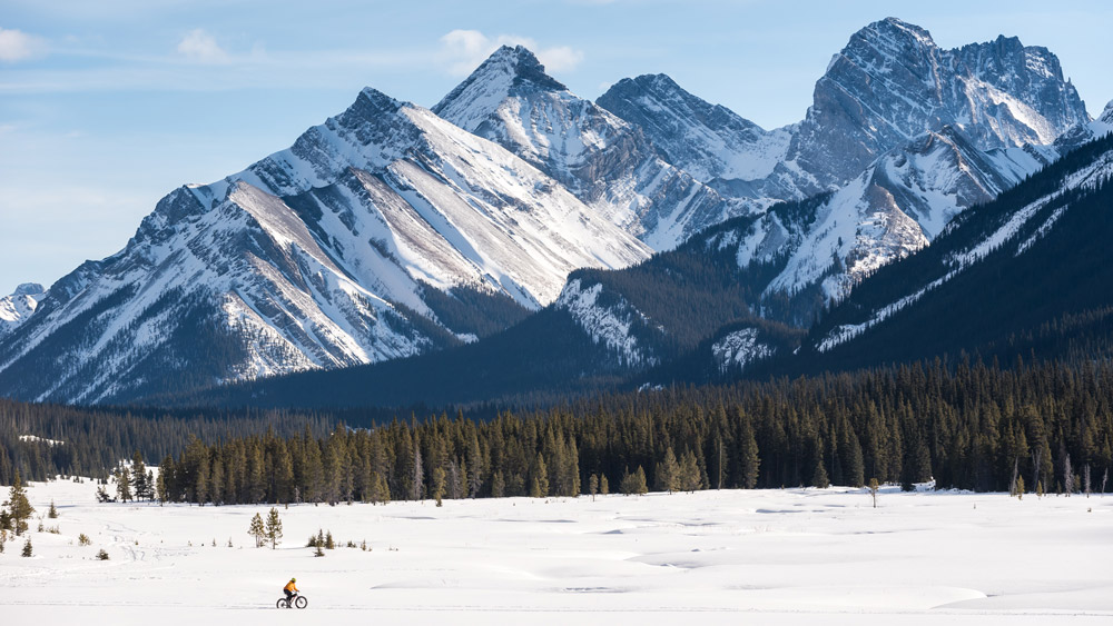Alberta winter images: Fat Biking in Kananaskis Country on a cold winter morning provides epic views of the Canadian Rockies