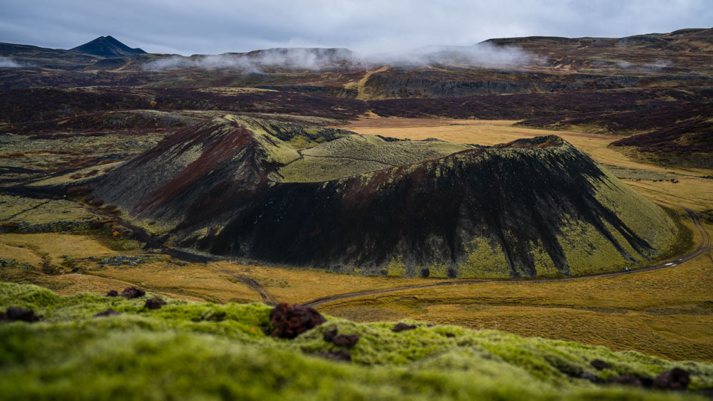 A beautiful volcano crater surrounding by Iceland autumn colors.