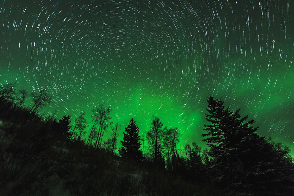 an easy example of how to photograph star trails during an epic northern lights display in northern Alberta