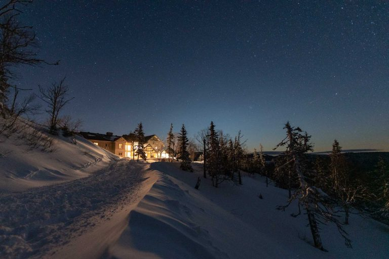 The Auberge du Montagne Des Chic-Chocs sit beneath a start filled sky. It's a backcountry ski lodge on the Gaspe Peninsula, in Quebec.