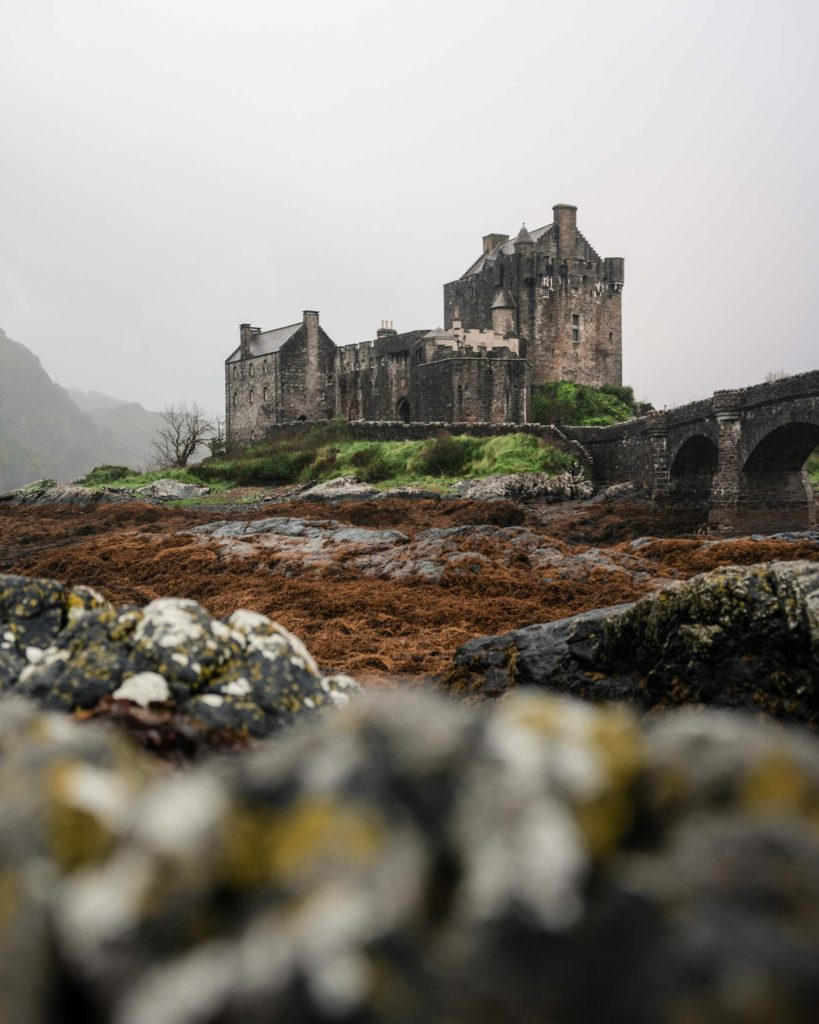 The Eilean Donan Castle lies at the entrance to Isle of Skye. This image shows it on a typical Scottish day, with cloud and fog isolating the castle from its surroundings.
