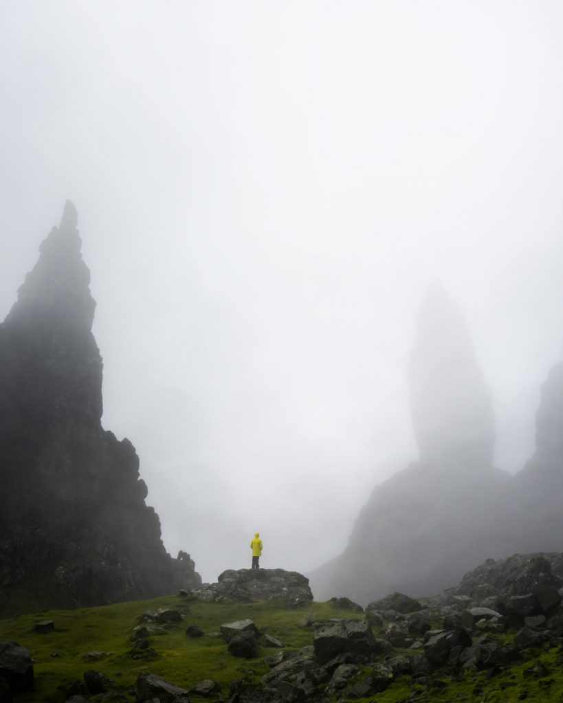 Old Man of Storr, a rocky outcrop on the Isle of Skye, is shown in dramatic foggy weather. This image was captured by Conor MacNeill while scouting for our f8 Photo Workshop.