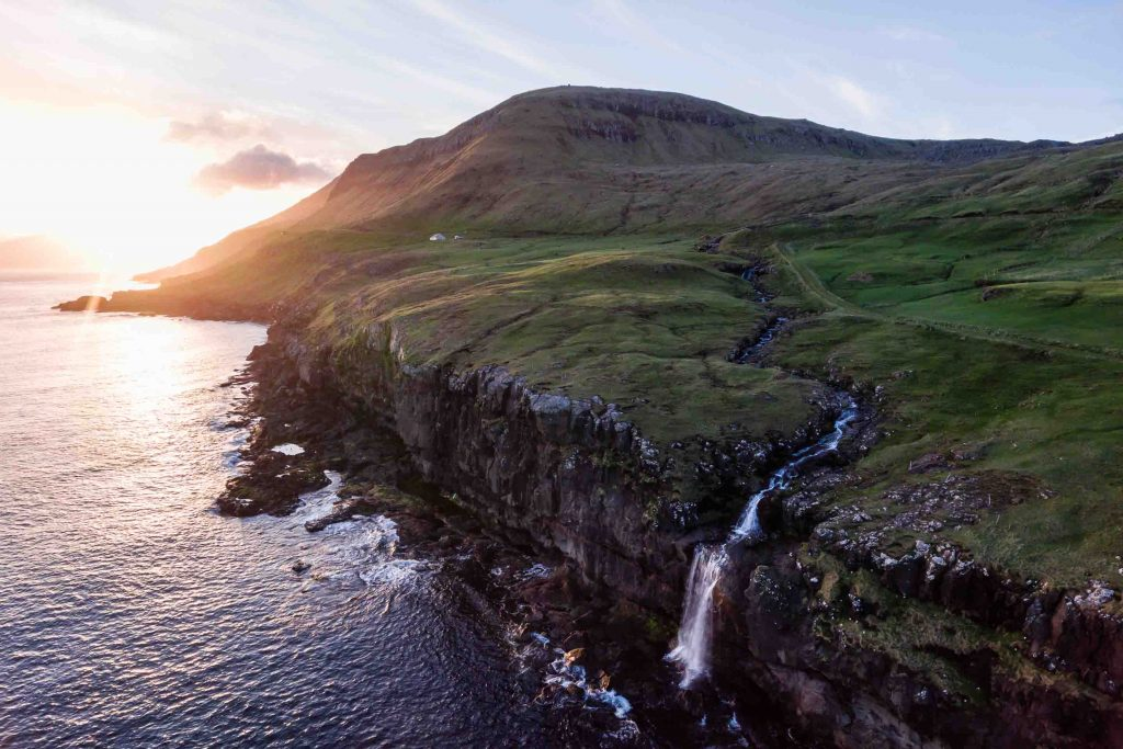 In the Faroe Islands, rivers flow towards the ocean and plunge off dramtic sea cliffs into the sea. It's a unique scene that isn't found in many locations; however, there are dozens in the country.