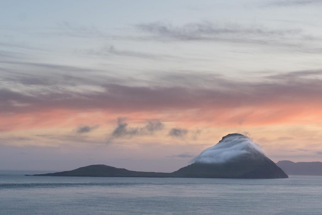 The Faroe Islands has dramatic, yet often dreary weather, yet sunsets can still be incredible. On this one occassion, a beautiful sunset illuminated Koltur Island for nearly an hour, while the rest of the Islands were clouded over.