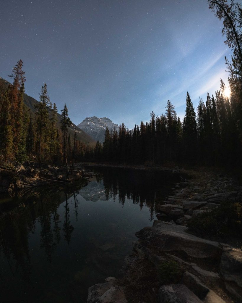 The small lakeside trail at Horseshoe Lake frames a reflection of Mt Kerkeslin, an iconic summit in Jasper National Park.