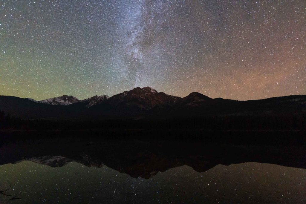 Pyramid mountain and the milky way, reflected in Pyramid Lake in Jasper National Park.