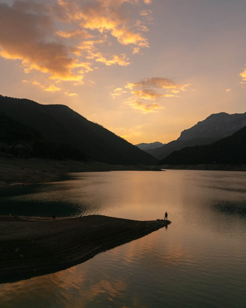 The stunning Piva Lake, in Montenegro, during a dramatic sunset. The lake is formed by a hydrodam and shows a major threat to the region. Over 2800 dams are proposed for this area.