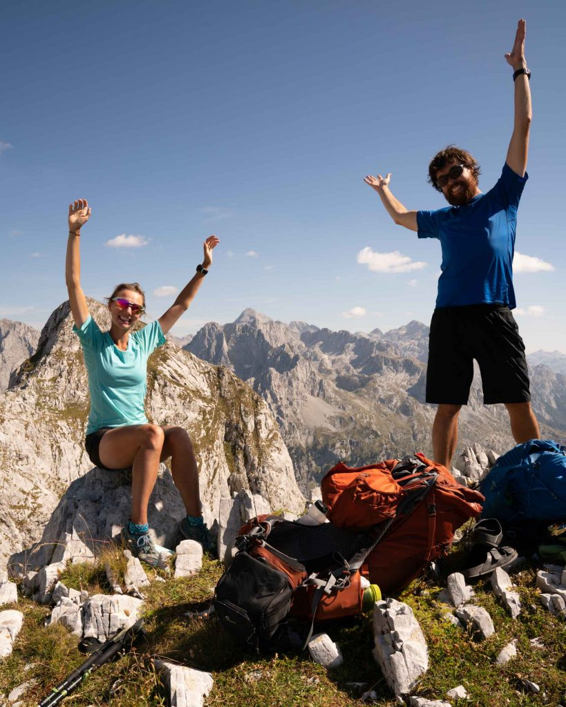 After two months on the trail, two hikers exclaim joy while posing for a selfie near the end of the Via Dinarica White Trail in Albania.