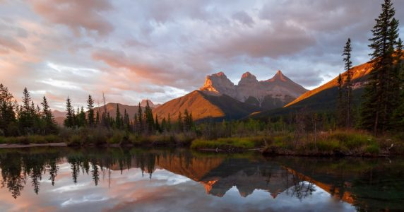 sunrise over the Canadian Rockies Three Sister Group just outside Canmore, Alberta, Canada