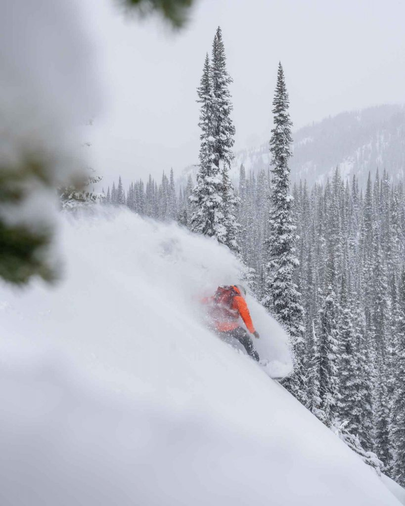 ACMG Ski Guide and Eddie Bauer athlete Scott Newsome drops into his first turns with a new group at Eagle Pass Heliskiing in Revelstoke, British Columbia